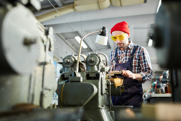 Factory Worker using Machine Unit - Stock Photo - Images