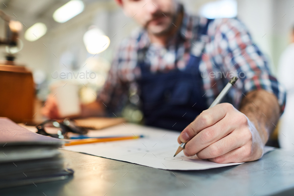 Worker  Drawing Plans Closeup - Stock Photo - Images