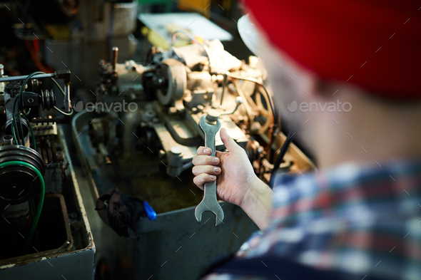 Unrecognizable Mechanic Holding Wrench - Stock Photo - Images