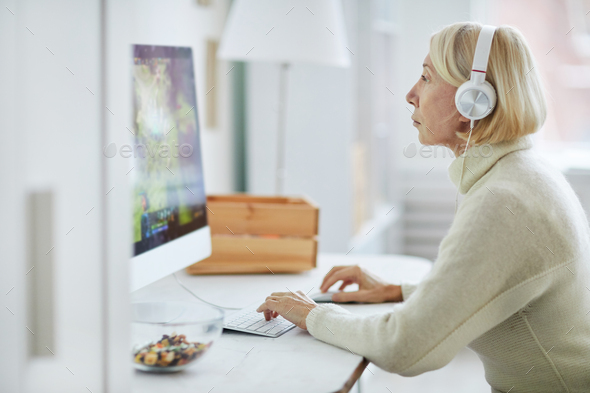 Mature Woman Using PC - Stock Photo - Images