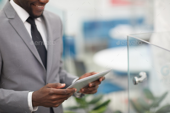African Businessman Holding Digital Tablet - Stock Photo - Images