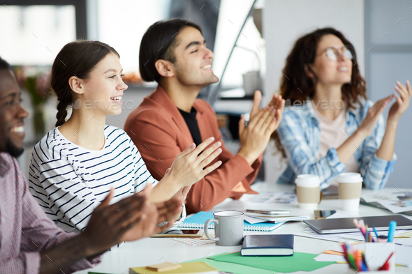 Young People Clapping for Presentation - Stock Photo - Images