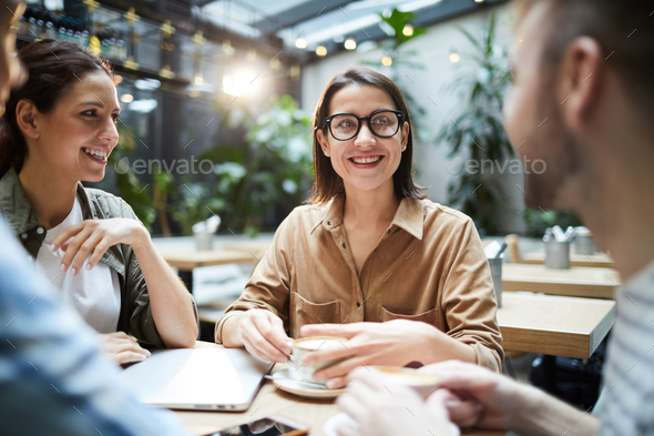 Young entrepreneurs discussing project development - Stock Photo - Images