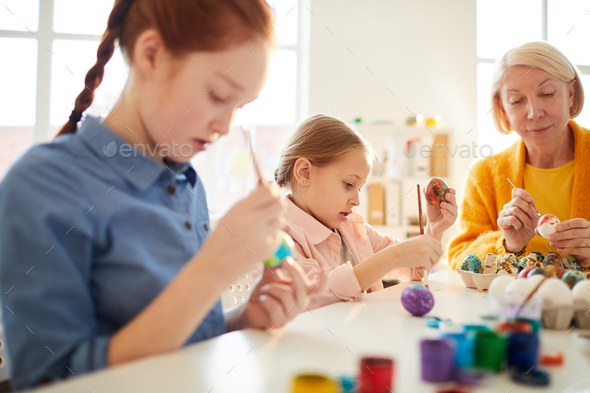 Kids Painting Eggs for Easter - Stock Photo - Images