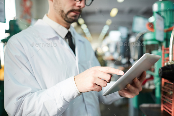 Factory Worker Holding Tablet - Stock Photo - Images
