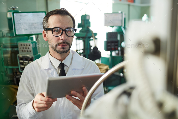 Mature Factory Worker Using Tablet - Stock Photo - Images