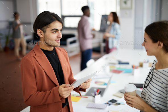 Middle-Eastern Businessman Talking to Colleague - Stock Photo - Images