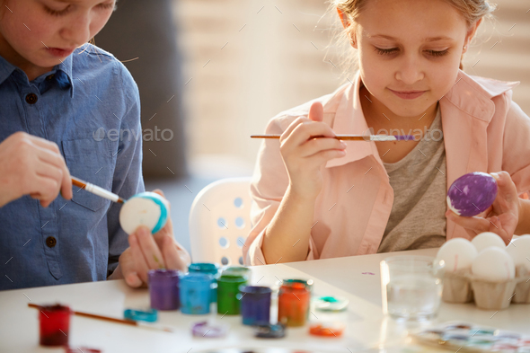 Girls Decorating Easter Eggs - Stock Photo - Images