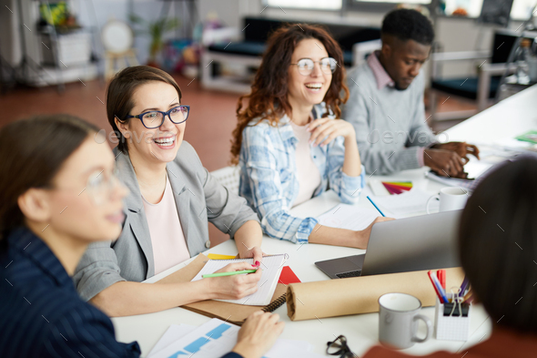 Smiling Business People at Table - Stock Photo - Images
