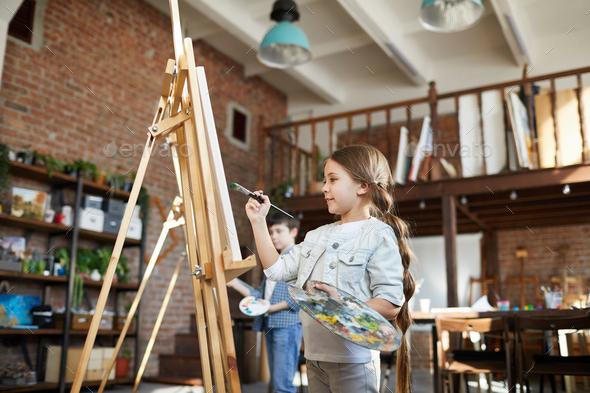 Cute Schoolgirl painting - Stock Photo - Images
