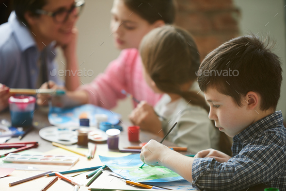Cute Boy Painting - Stock Photo - Images