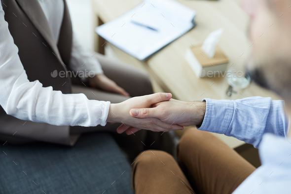 Shaking hand with counselor - Stock Photo - Images
