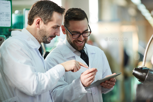 Two Factory Workers Wearing Lab Coats - Stock Photo - Images