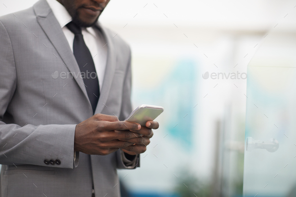 African Businessman Using Smartphone Closeup - Stock Photo - Images