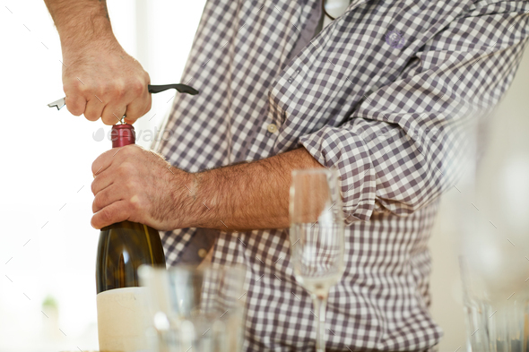 Drawing cork from wine bottle - Stock Photo - Images
