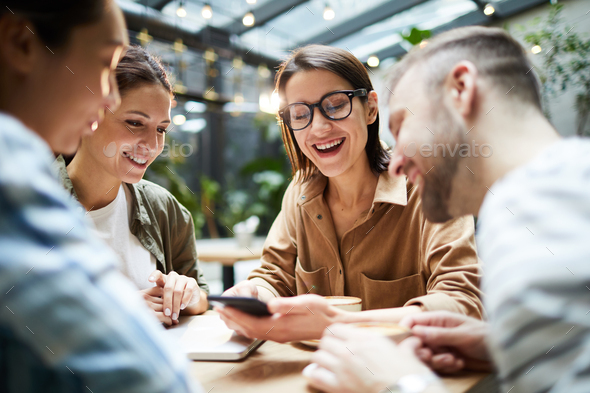 Positive friends gathering in cafe - Stock Photo - Images