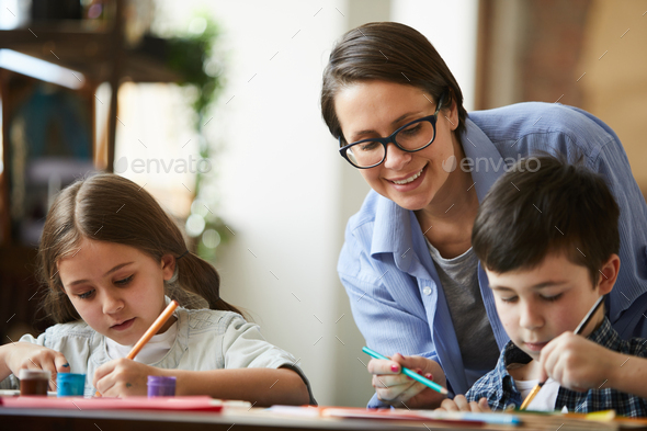 Happy Mother Painting with Children - Stock Photo - Images