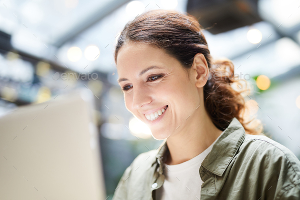 Jolly woman using modern device - Stock Photo - Images
