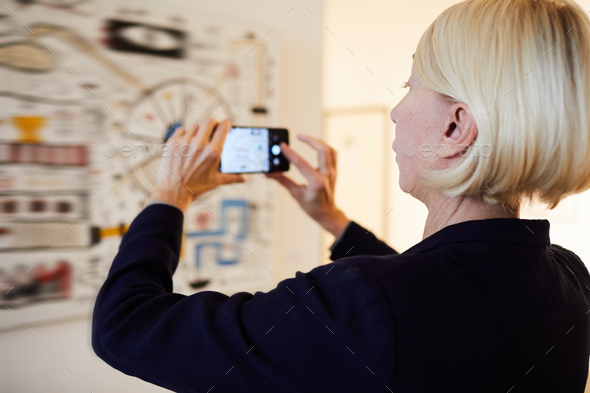 Gallery Visitor Taking Photo of Painting - Stock Photo - Images