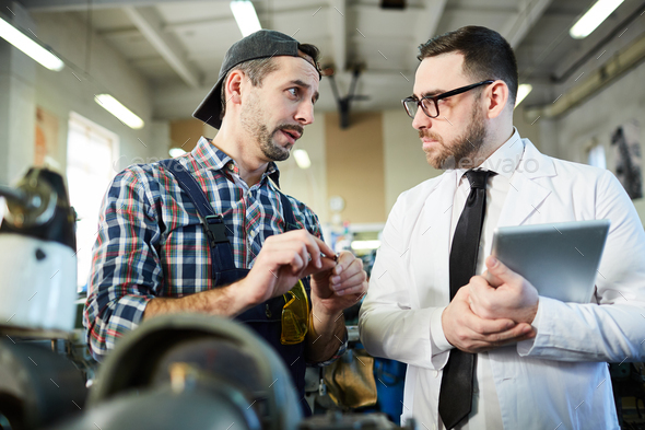 Factory Manager Talking to Worker - Stock Photo - Images