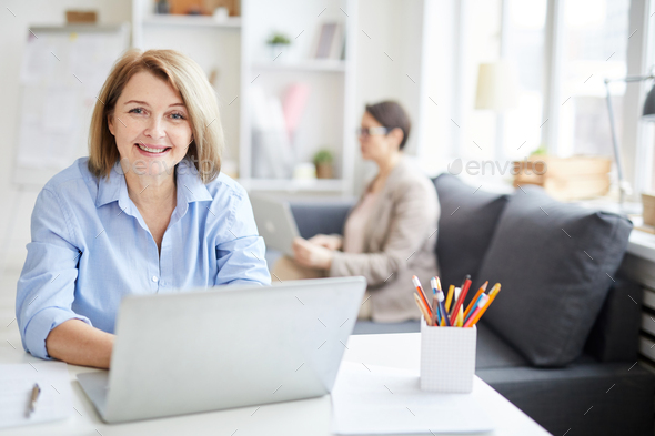 Adult Woman Enjoying Work in Office - Stock Photo - Images