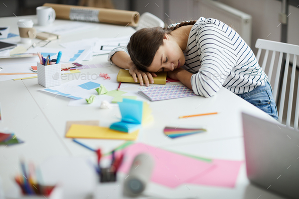 Tired Student Sleeping on Desk - Stock Photo - Images