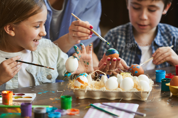 Two Kids Painting Easter Eggs - Stock Photo - Images