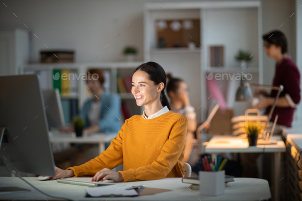 Woman in front of computer - Stock Photo - Images