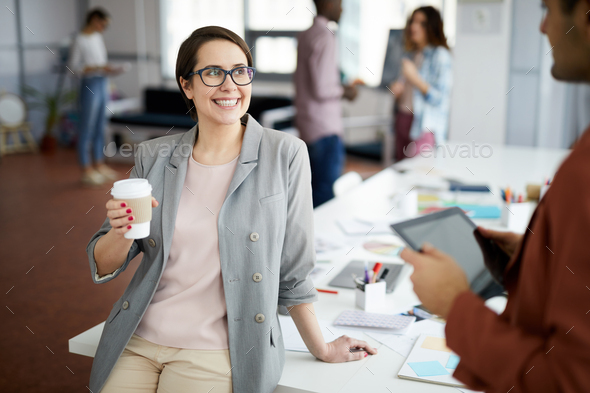 Contemporary Businesswoman at Coffee Break - Stock Photo - Images