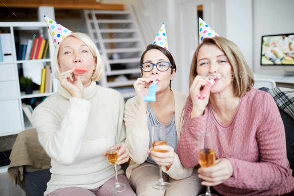 Women Blowing Party Horns - Stock Photo - Images