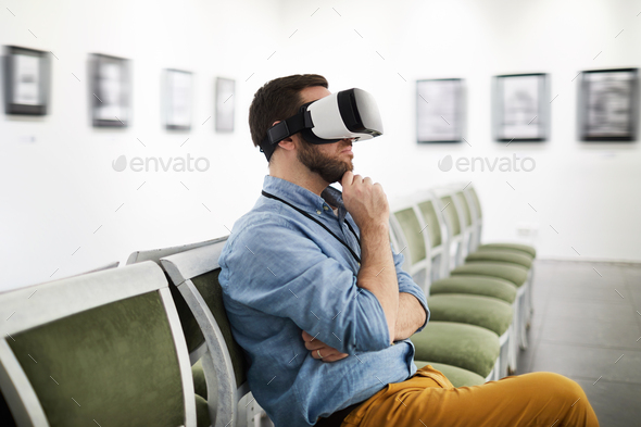 Man Wearing VR in Museum - Stock Photo - Images