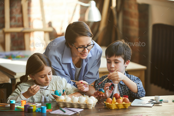 Family Painting Easter Eggs - Stock Photo - Images