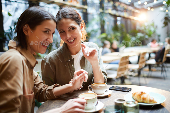 Gossiping about people in cafe - Stock Photo - Images