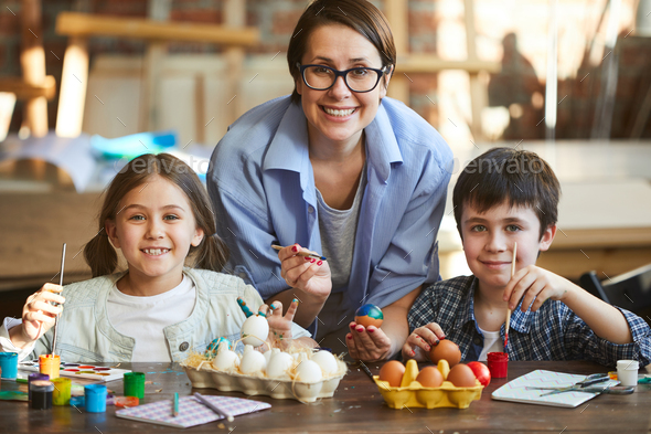 Family Decorating Easter Eggs - Stock Photo - Images