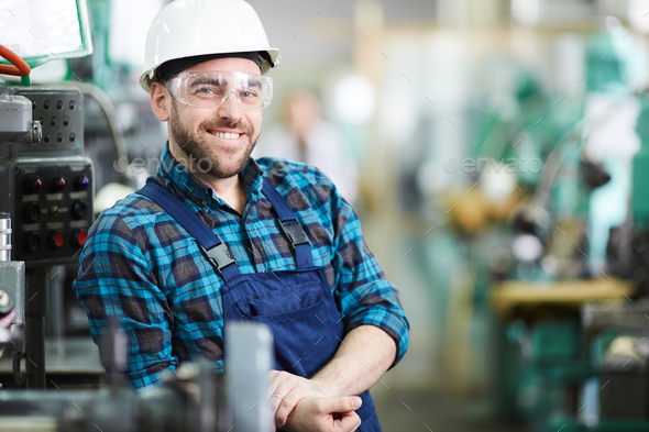 Smiling Factory Worker Posing - Stock Photo - Images