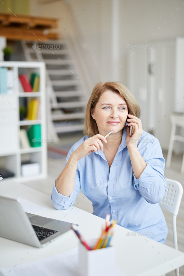 Mature Businesswoman Talking by Phone - Stock Photo - Images