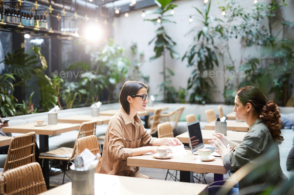 Women brainstorming about project - Stock Photo - Images