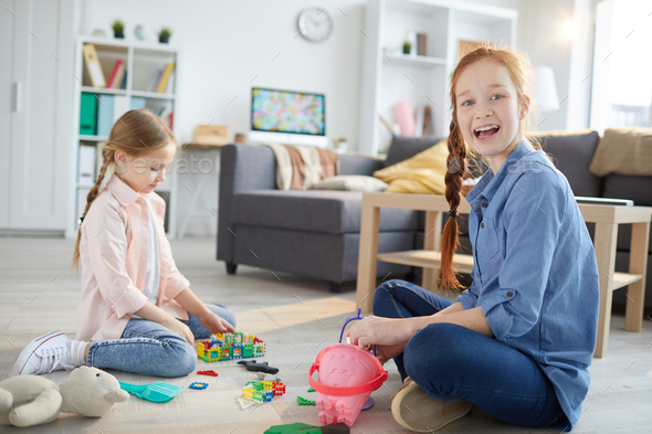 Two Sisters Playing at Home - Stock Photo - Images