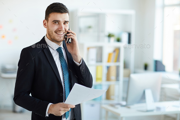 Banker with phone and paper - Stock Photo - Images