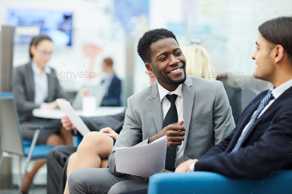 Two Office Workers Talking - Stock Photo - Images