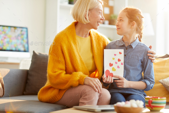 Daughter Giving Valentines Card to Mom - Stock Photo - Images