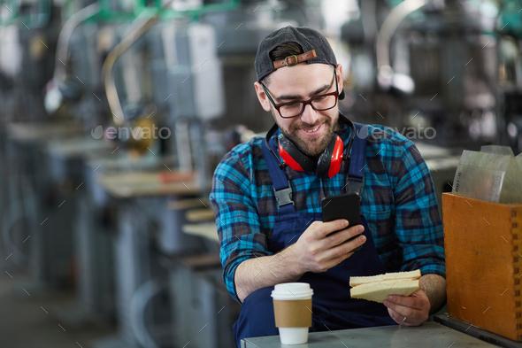Worker Using Smartphone on Break - Stock Photo - Images