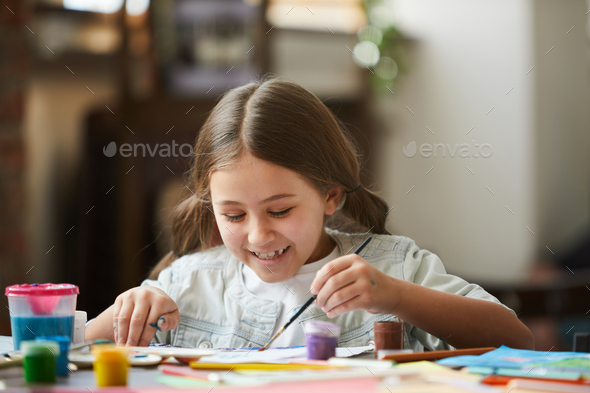 Little Girl Painting Picture - Stock Photo - Images