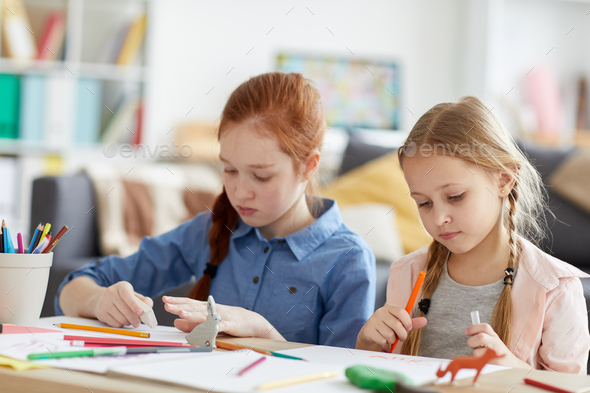 Two Girls Drawing at Home - Stock Photo - Images