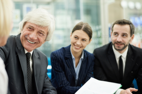 Senior Boss Meeting with Employees - Stock Photo - Images