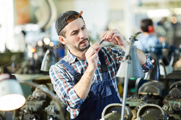 Mature Man Working at Plant - Stock Photo - Images