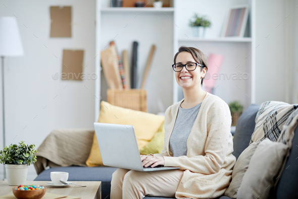 Smiling Businesswoman Using Laptop - Stock Photo - Images