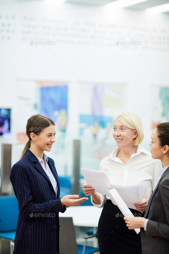 Businesswomen Talking in Office - Stock Photo - Images
