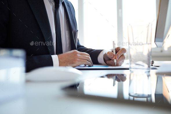 Making notes on paper - Stock Photo - Images