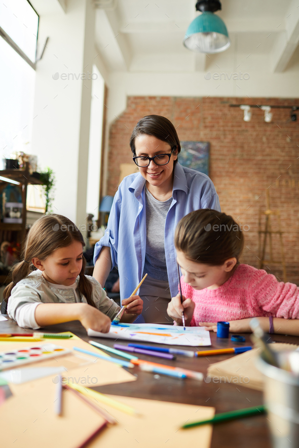 Modern Mother with Two Girls - Stock Photo - Images